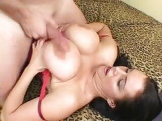 Sexy brunette MILF in stockings gets her massive tits fucked and anal